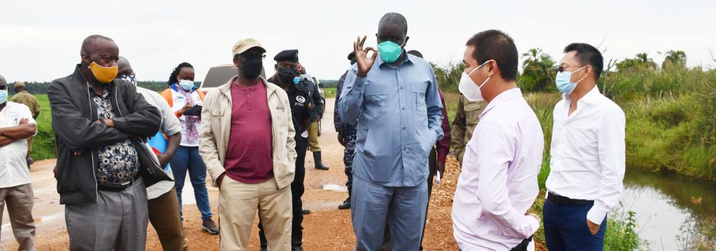 Water and Environment P.S Mr. Alfred Okot Okidi (3rd Left) with NEMA ED Dr. Barirega Akankwasah(C) during an inspection in Lwera